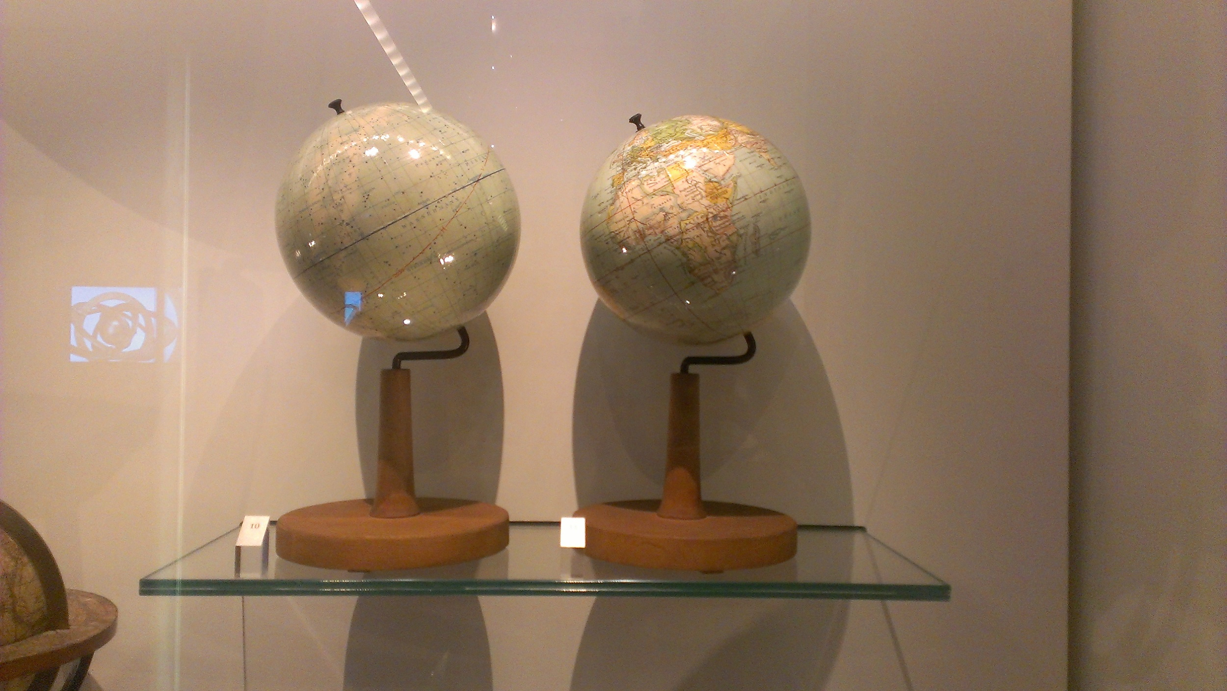 Celestial and terrestrial globe pair.  They look awesomely mid-century