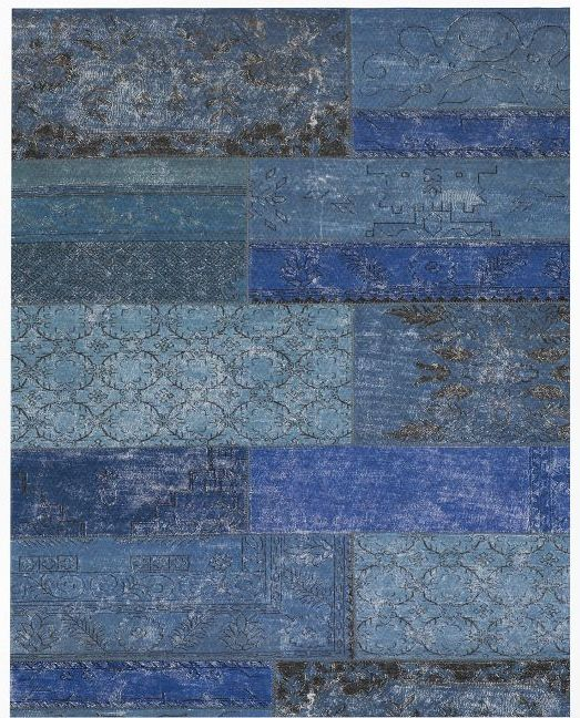 West Elm -  Cadiz Wool Rug . They must have used a 9'x12' in the set which retails at $1,300.