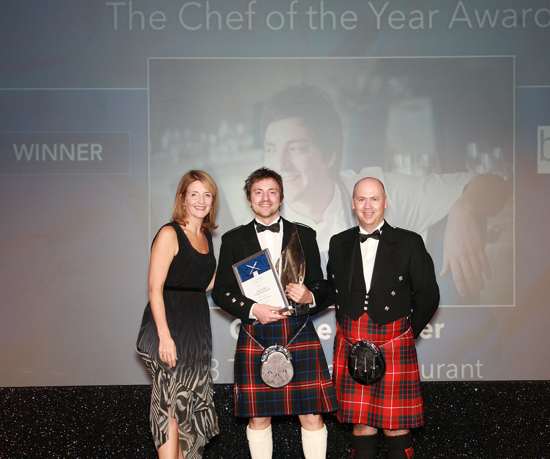 Graeme Pallister of   63 Tay Street   in Perth picks up the trophy from Kaye Adams