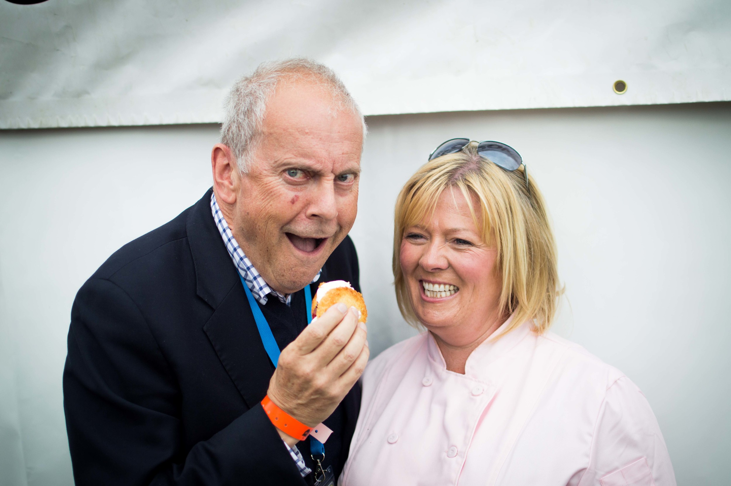 Cheeky! Gyles Brandreth shares a mini Victoria sponge with Jacqueline O'Donnell in Edinburgh