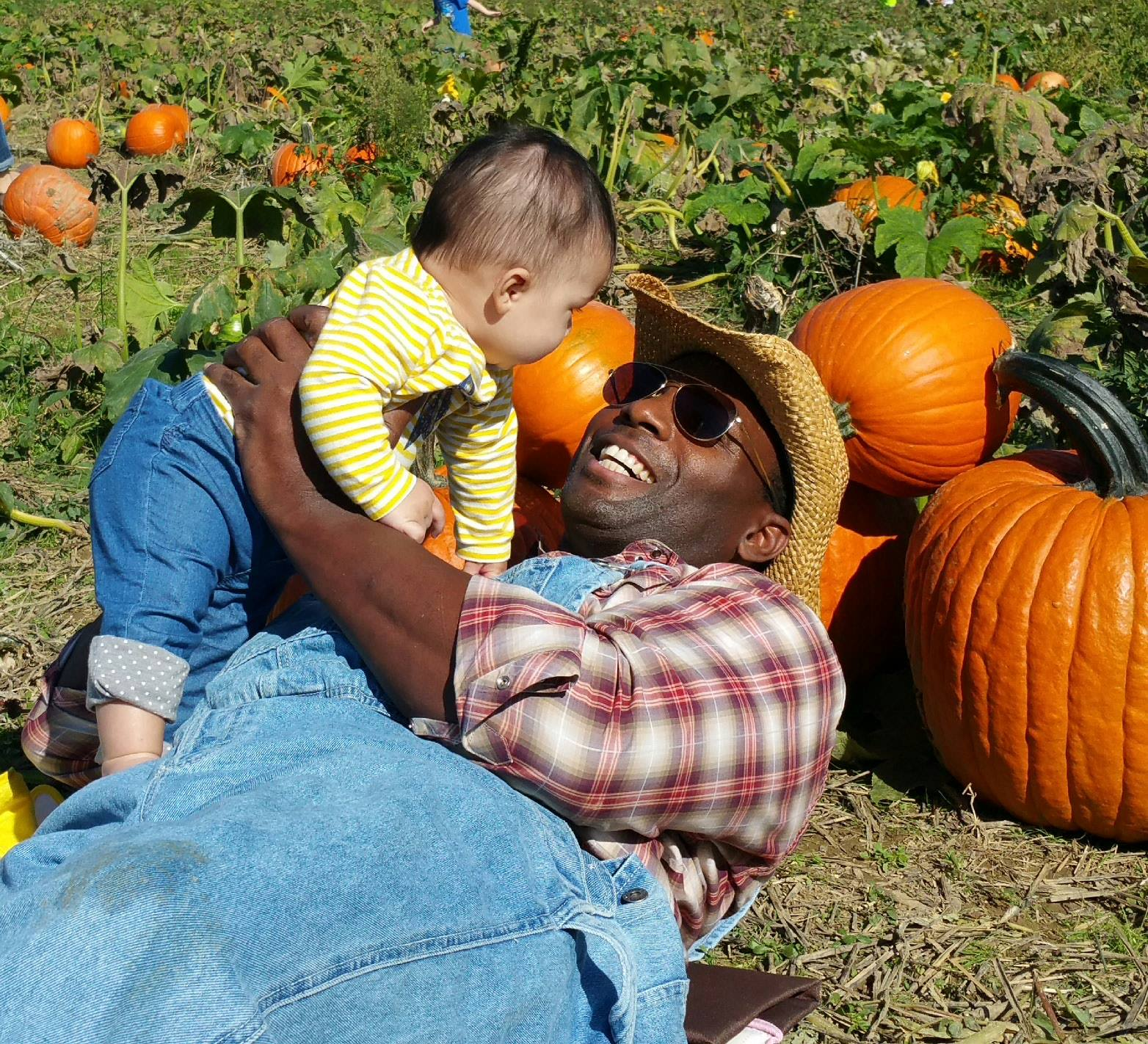 family in pumpkin patch.jpg