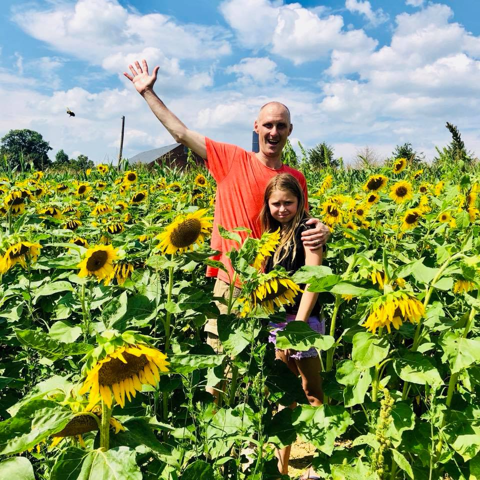 family in sunflowers kelley approved facebook.jpg