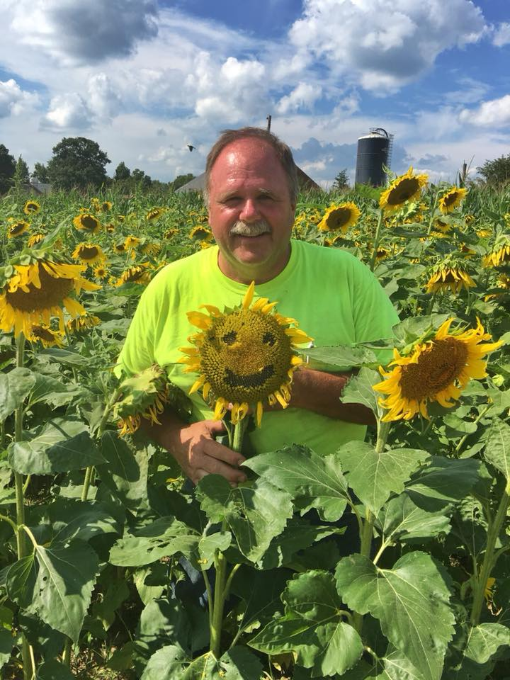 farmer Jim sunflower smiley.jpg