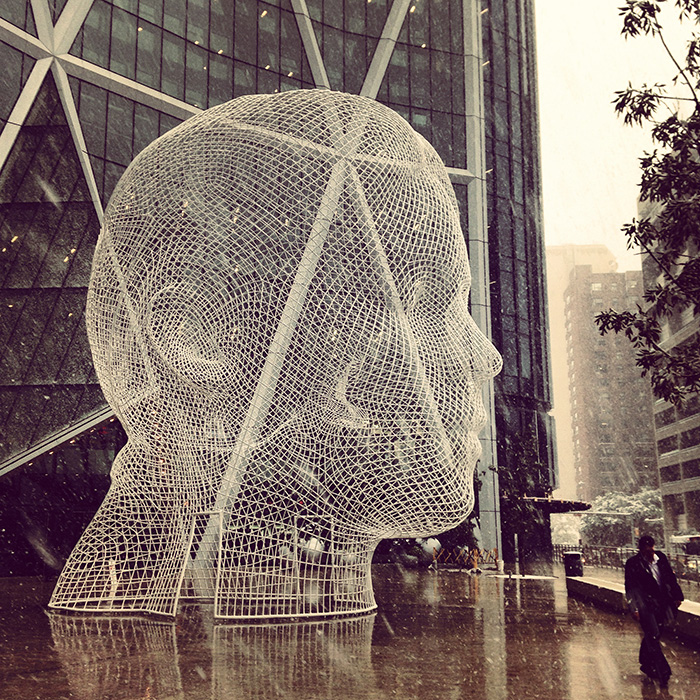 Jaume Plensa's sculpture outside the Bow and the beginnings of the September snow.