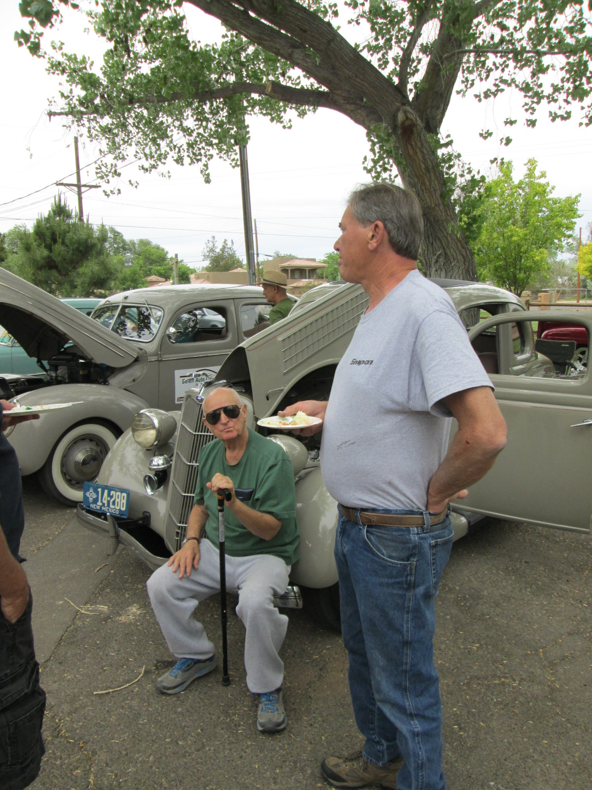 Marvin seated on his and Neva's 1935 talking to John about hot rod flatheads.  Congratulations on winning the DIck Precit traveling trophy this year!!