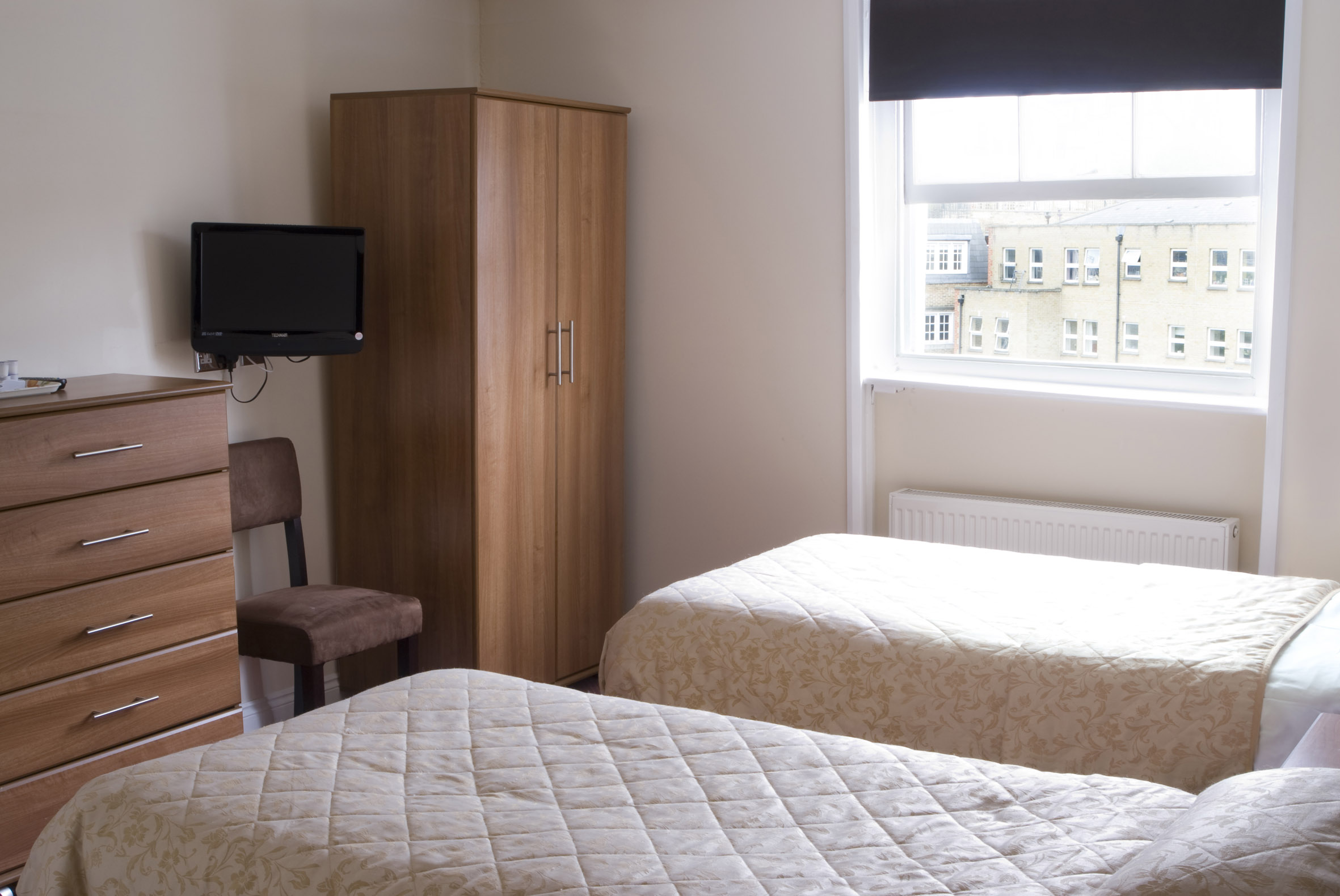Twin Room with private bathroom   Includes two single beds (sleeps up to two guests)