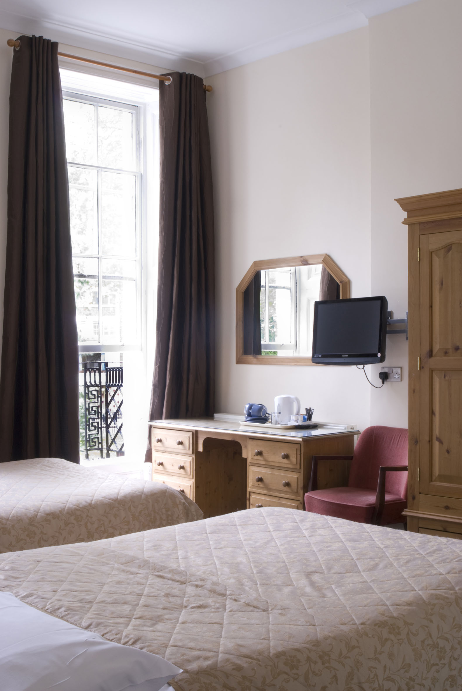 Quad Room with private bathroom    Includes two double beds or one double and two single beds - specify your preference (sleeps up to four guests)