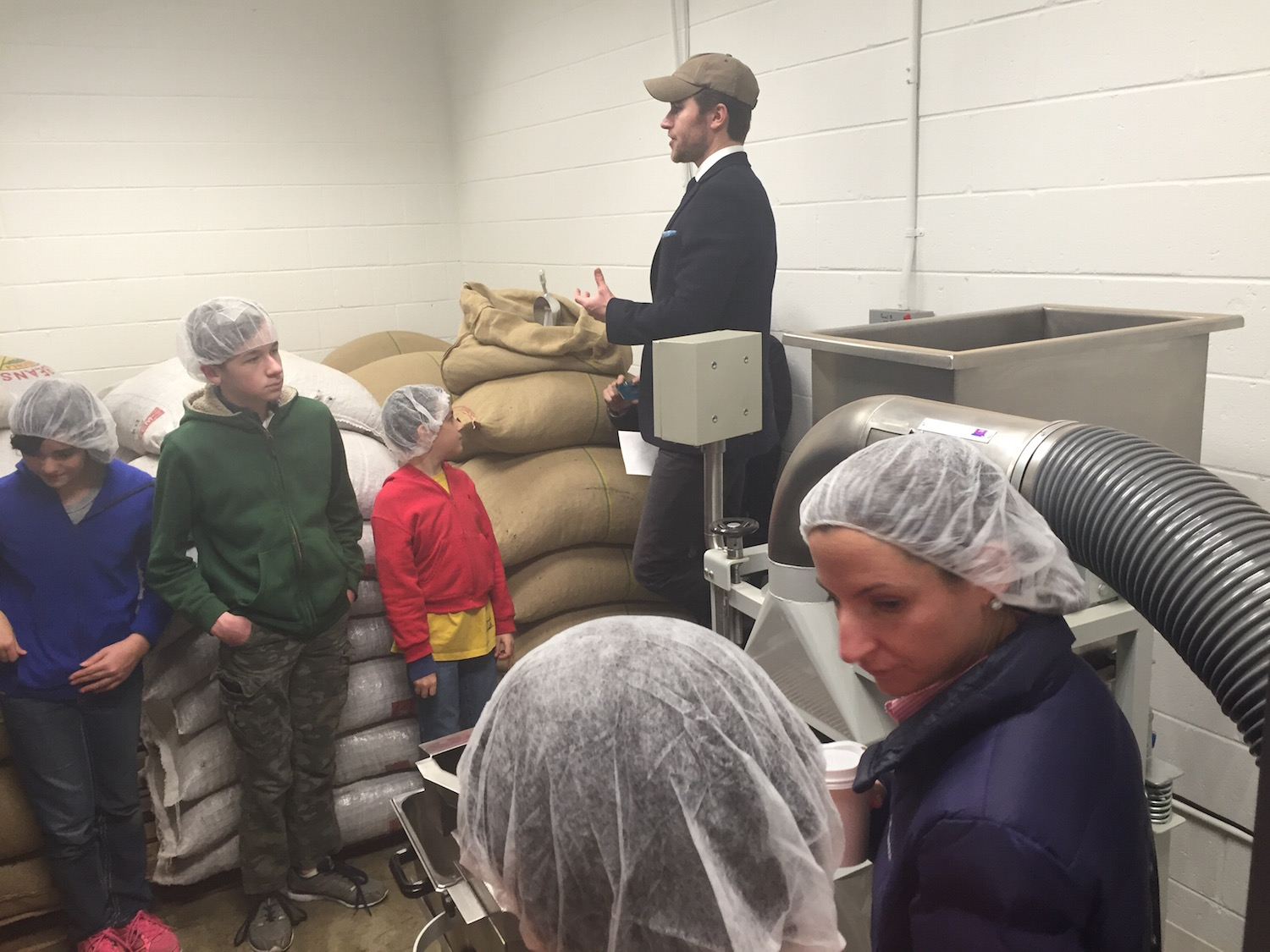 Owner Colin Hartman starts the tour in a room where the beans are stored and cleaned
