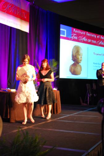 Mardie Rees receives her award