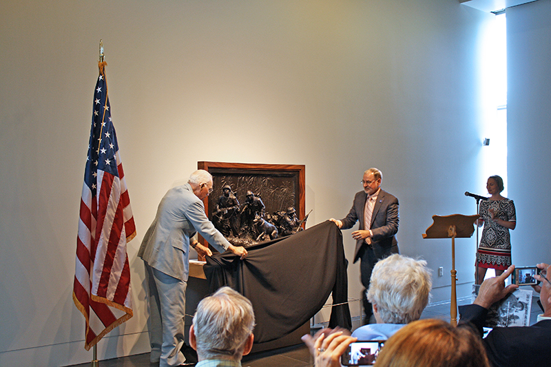 Charles Meacham Sr. (WWII Raider) & Charles Meacham Jr. unveil the sculpture