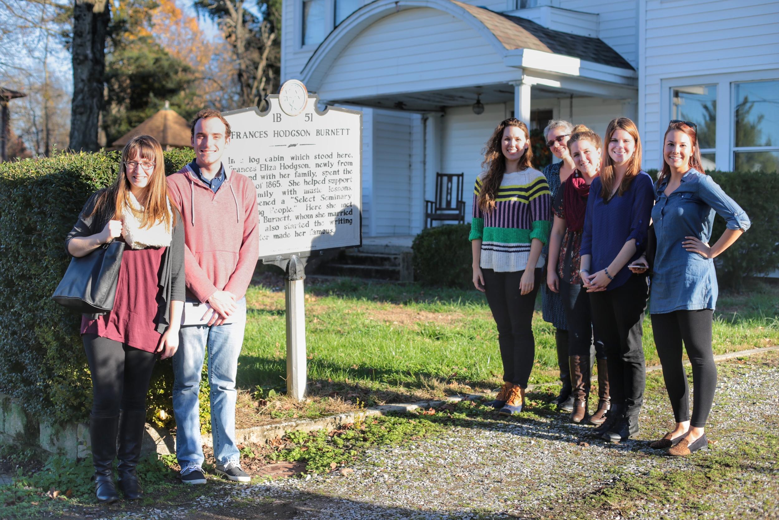 All seven students in front of Frances Hodgson Burnett's first American homesite in New Market, TN.