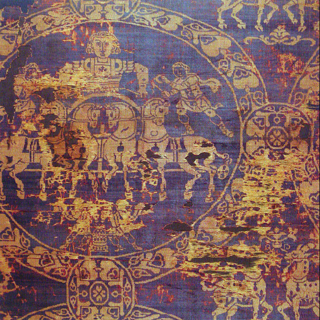 A fragment of the burial shroud of the Emperor of Charlemagne; dyed using gold and purple.  The tyrian purple dye is still quite strong despite having been created in 800 BC.