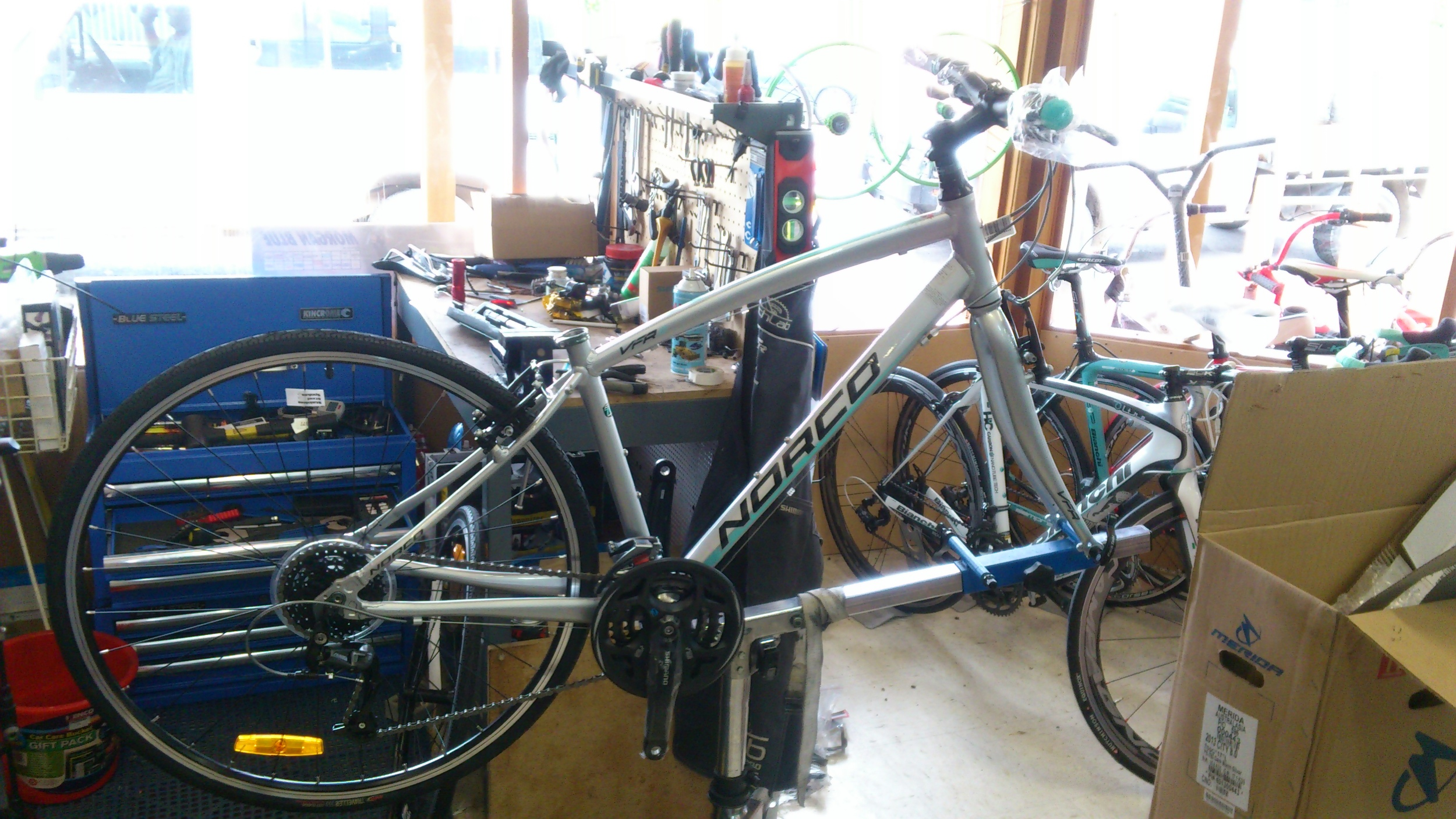 Bike ready for pedals and other parts. In the back gorund is our fully equipped workshop. This enables us to build and service most bike. By the way it is against Australian consumer starndards to sell a bike unassembled.