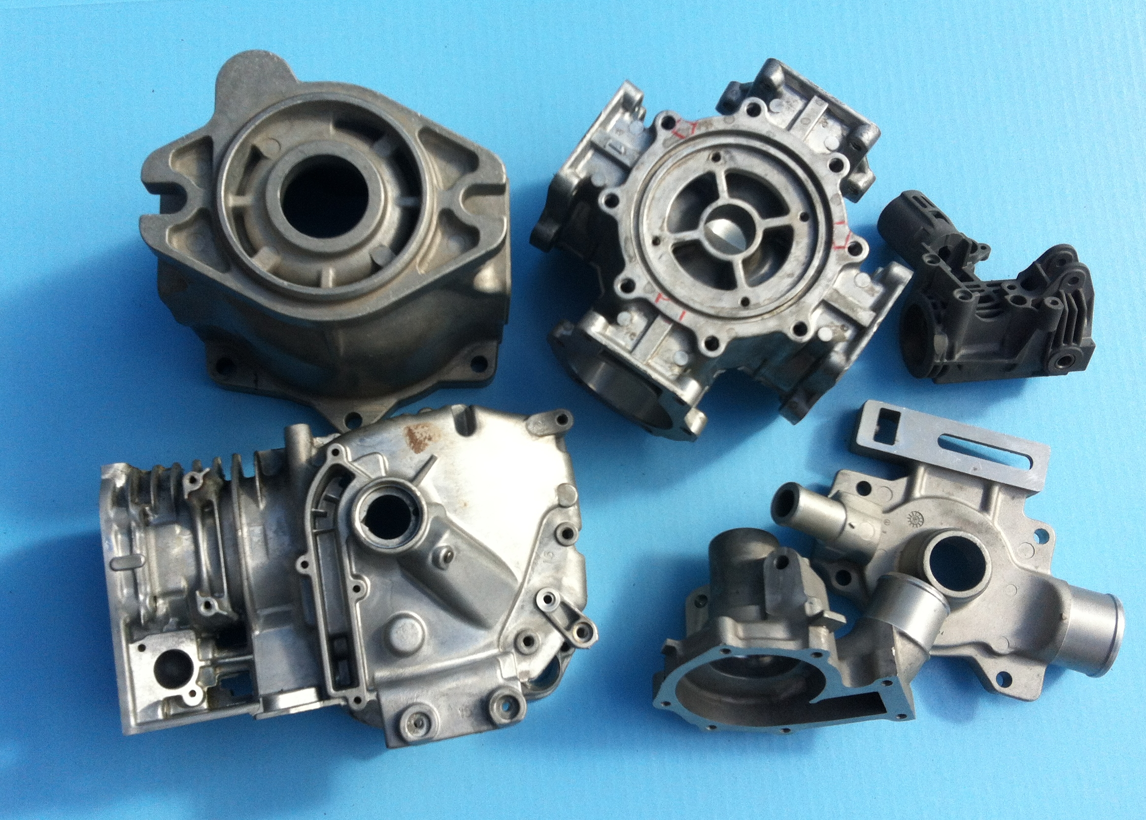 Examples of very complex die castings with all types of machining operations and many precision bores and surfaces.