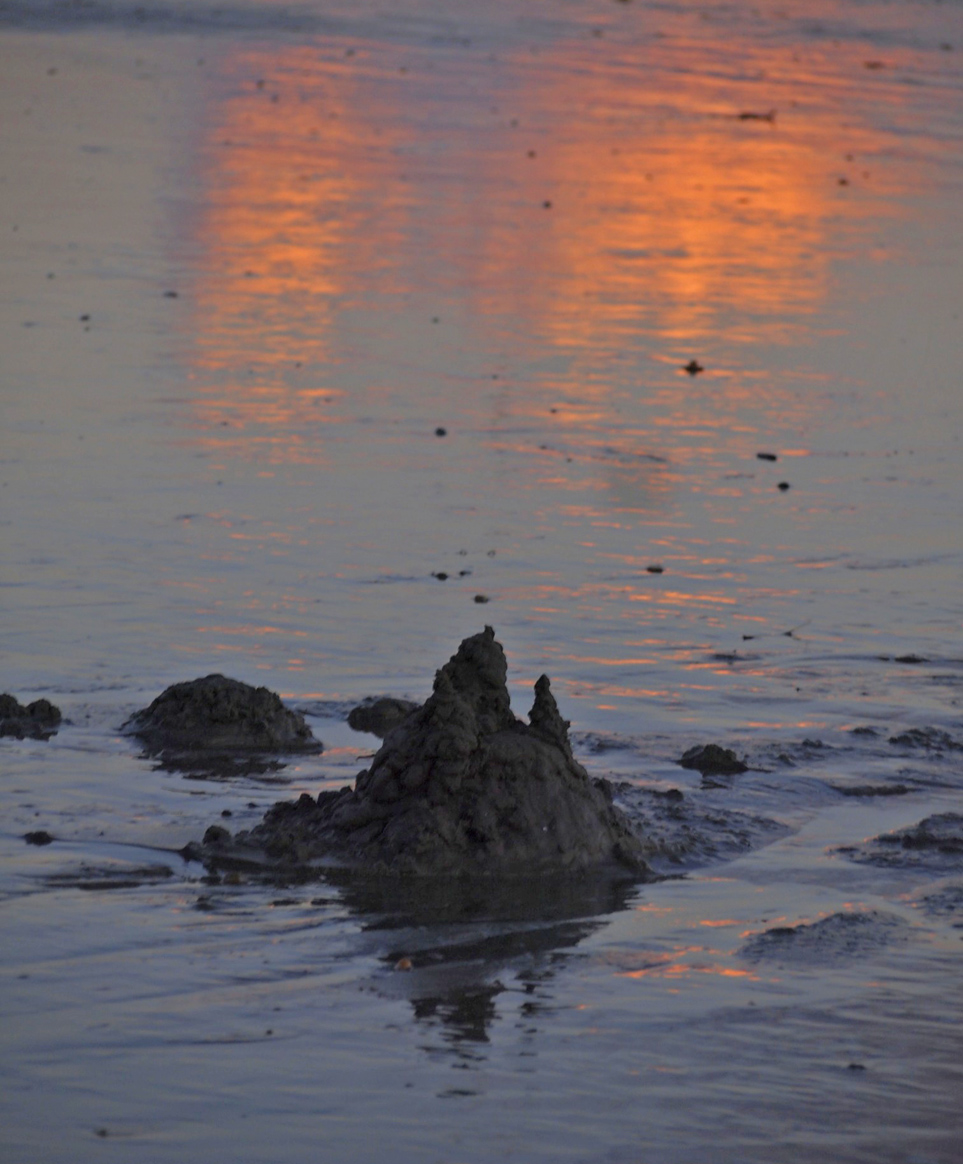drip sandcastle in blue and gold reflections