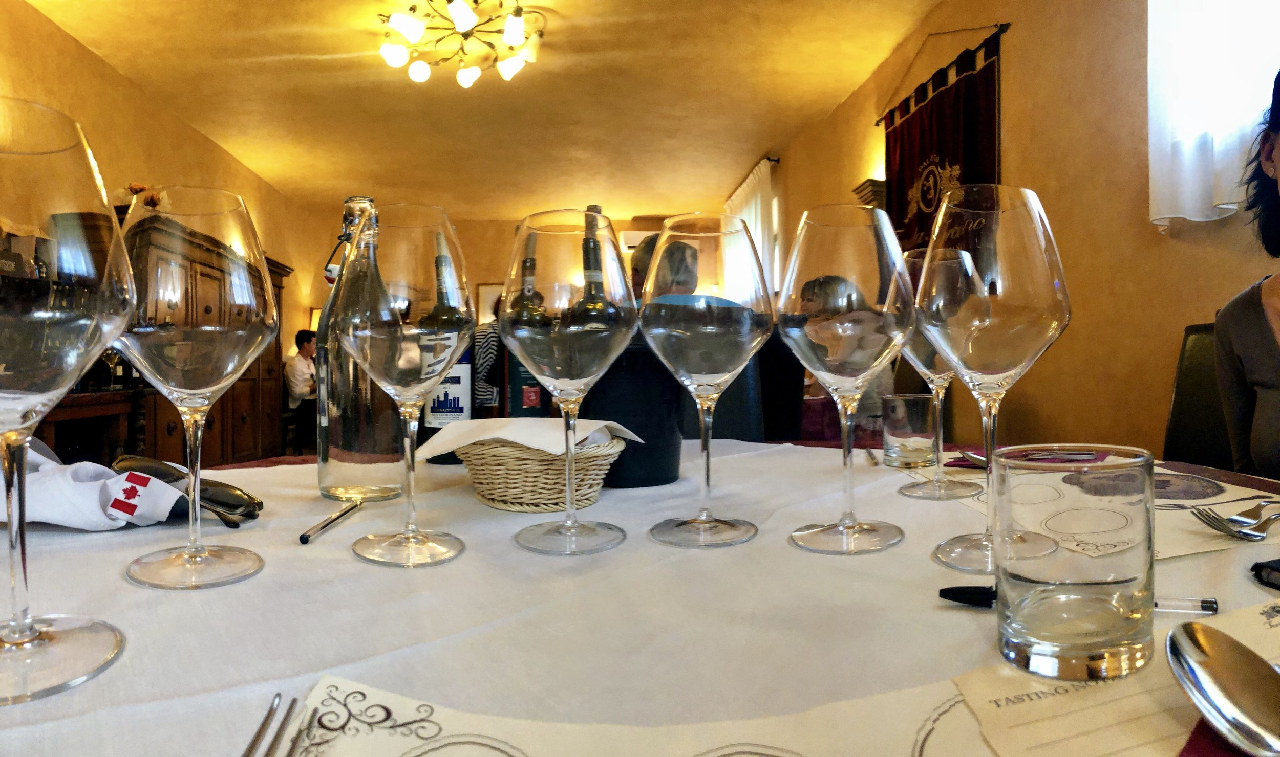 Empty glasses at Tenuta Torciano Winery