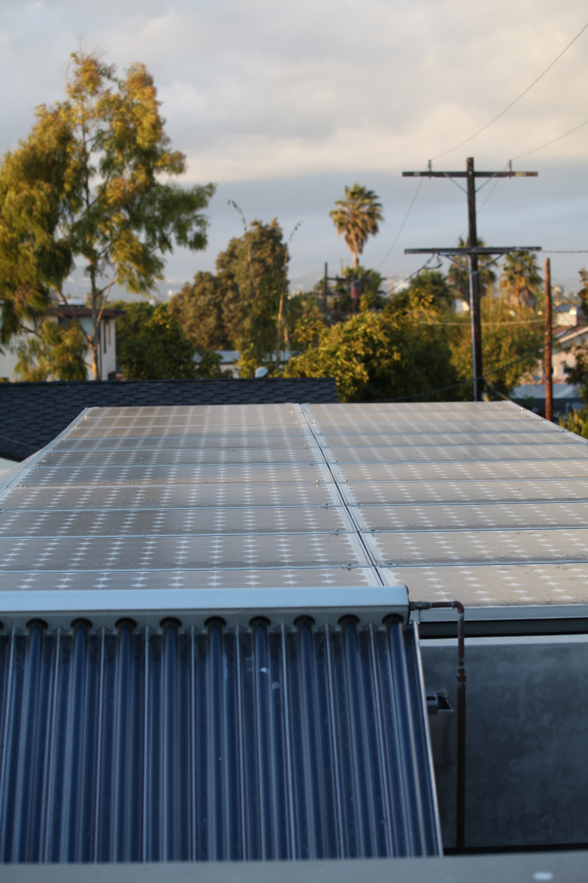 Photovoltaic panels and evacuated tube solar collectors on top of  the McKinley House  were an important part of the residence's energy balance and sustainable portfolio.