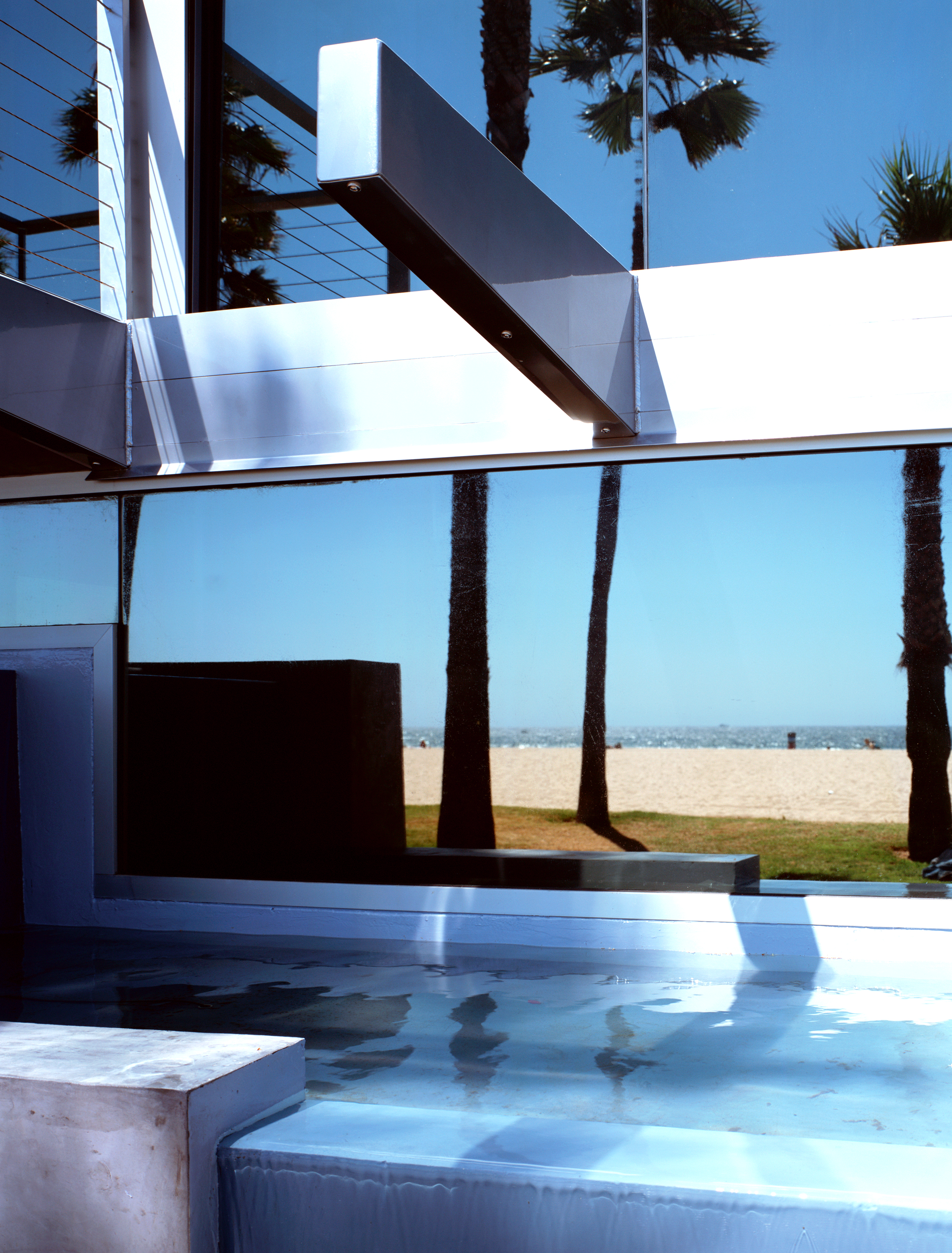 S.E.A.-Studio-Environmental-Architecture-David-Hertz-FAIA-Panel-House-Venice-Beach-California-sustainable-regenerative-restorative-green-design-prefabricated-aluminum-refrigeration-open-concept-ocean-view-residential-glass-steel-sunset-exterior-13.jpg