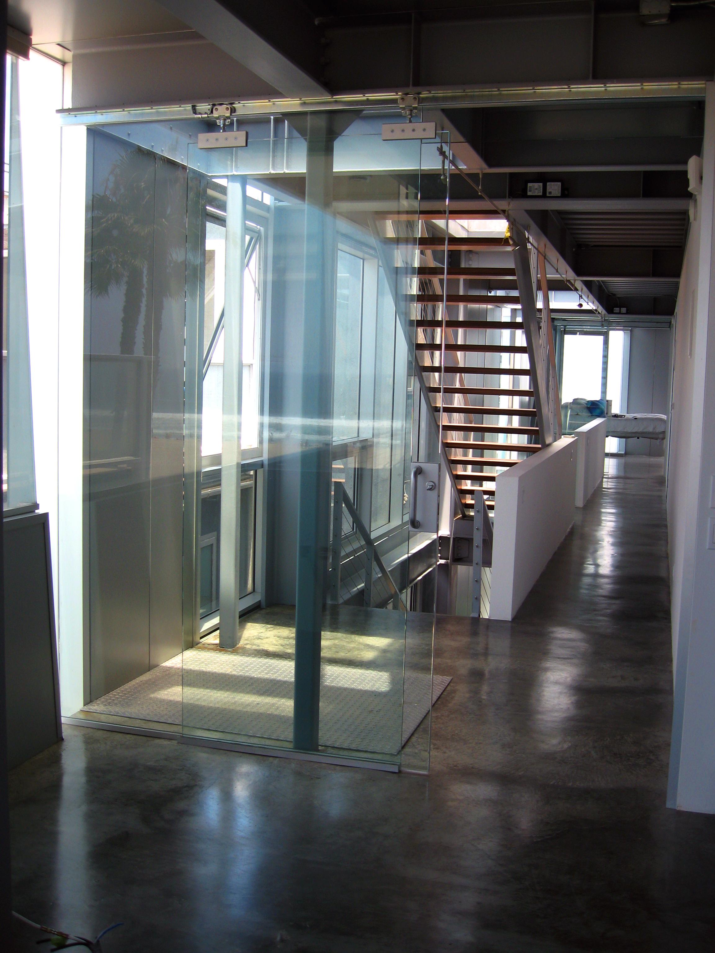 S.E.A.-Studio-Environmental-Architecture-David-Hertz-FAIA-Panel-House-Venice-Beach-California-sustainable-regenerative-restorative-green-design-prefabricated-aluminum-refrigeration-open-concept-ocean-view-residential-glass-steel-sunset-interior-10.jpg
