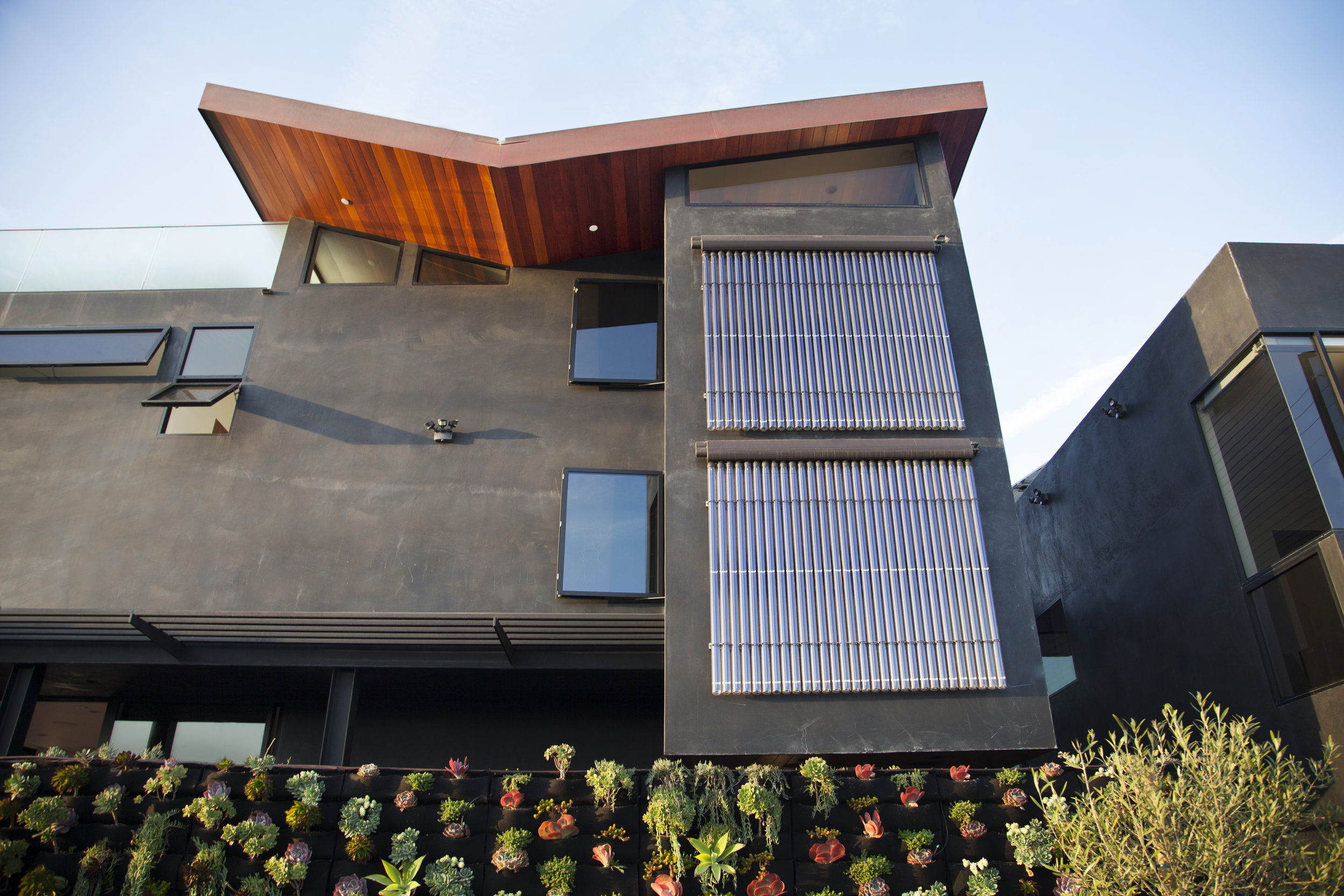 S.E.A.-Studio-Environmental-Architecture-David-Hertz-FAIA-Butterfly-House-Venice-Beach-California-sustainable-regenerative-restorative-green-design-renewable-energy-evacuated-tube-solar-collector-residential-green-wall-stormwater-natural-ventilation-E.jpg