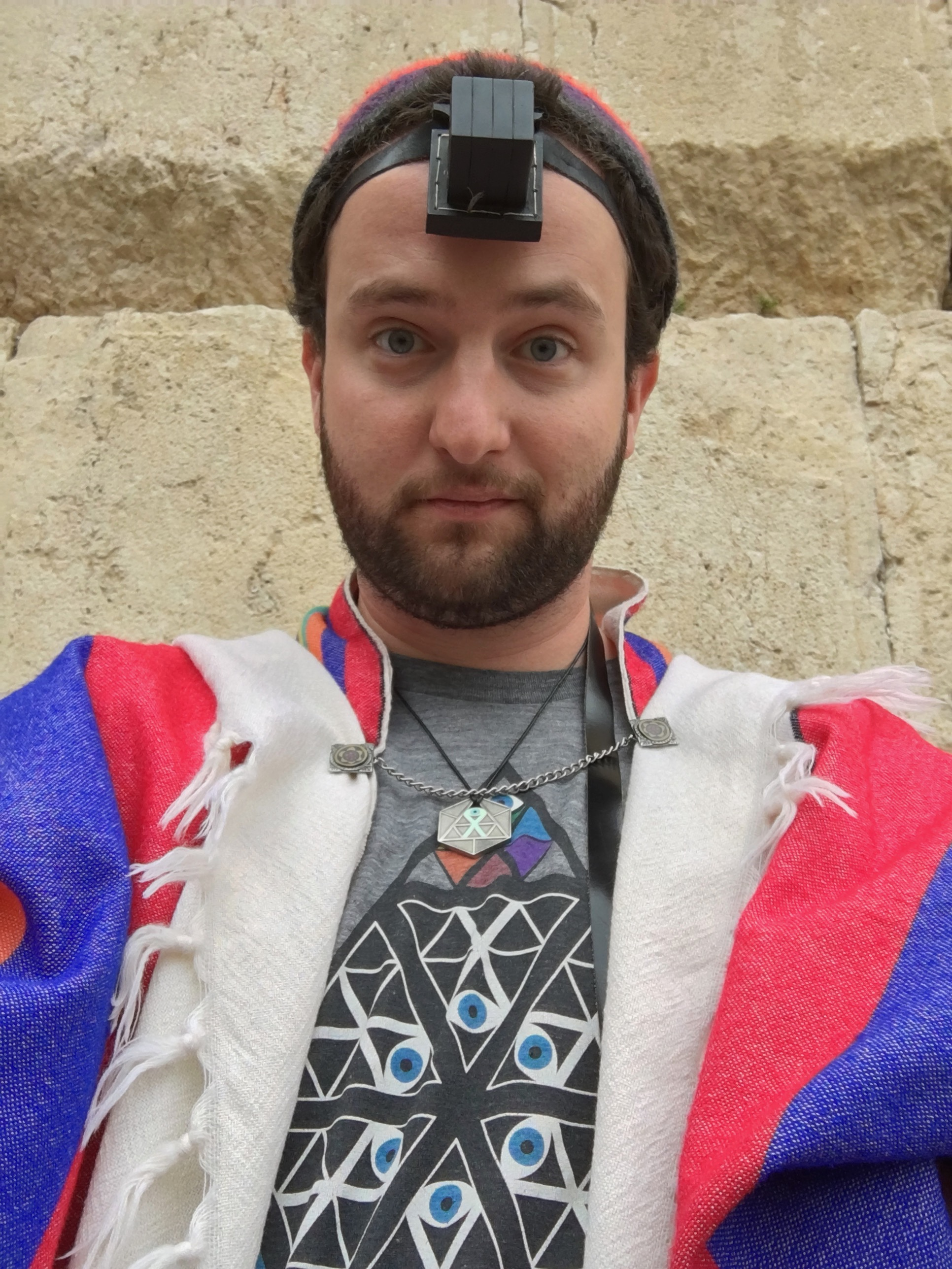 A ridiculous selfie I took at the Kotel. Note that I'm repping the  Temple of Whollyness  at, you know, the Temple of Holiness.