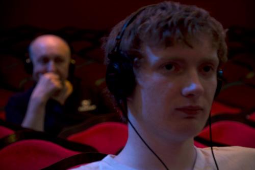 Audience members listening to love stories