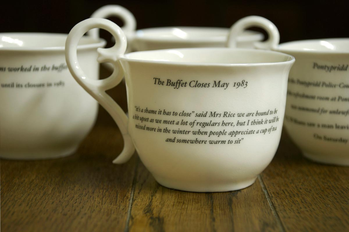 Fired bone china, slip cast cups, with decals. Inscription from archived local Newspapers.