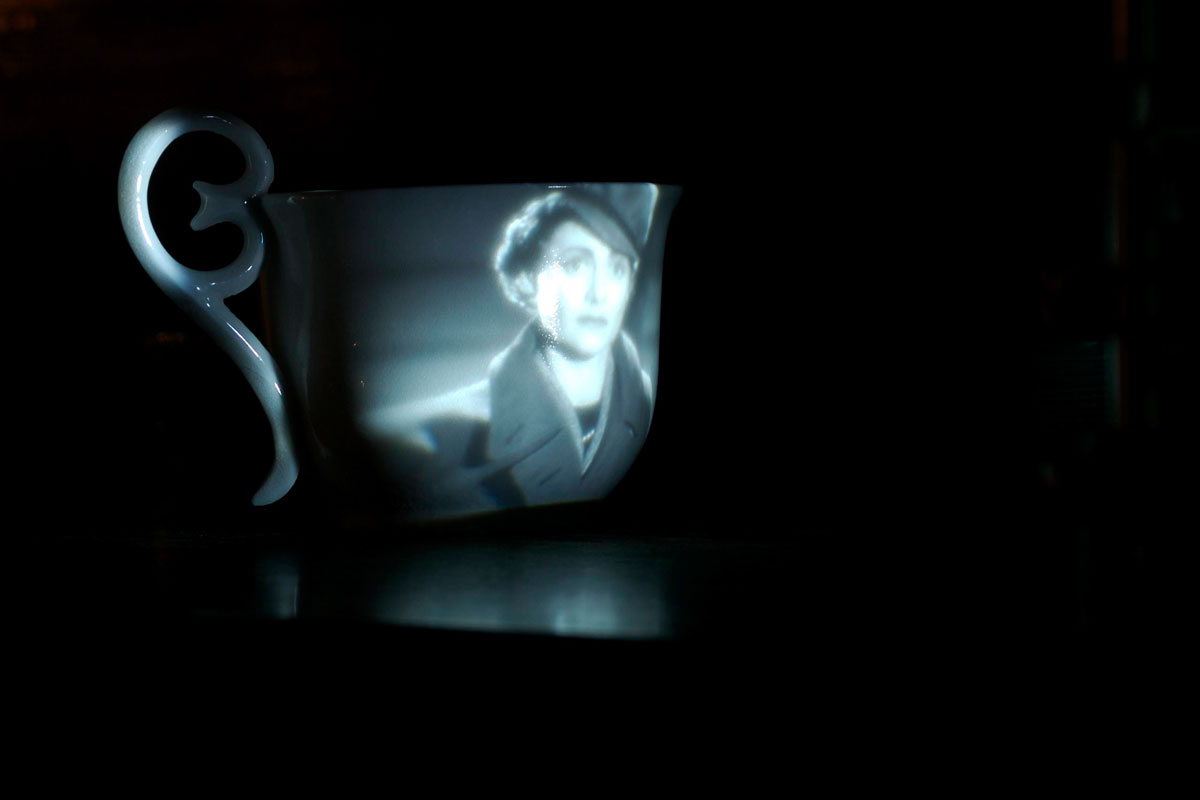 Fired bone china cup with video projection of the 1948 film 'Brief Encounter' shown in its entirety in situ in the disused buffet.