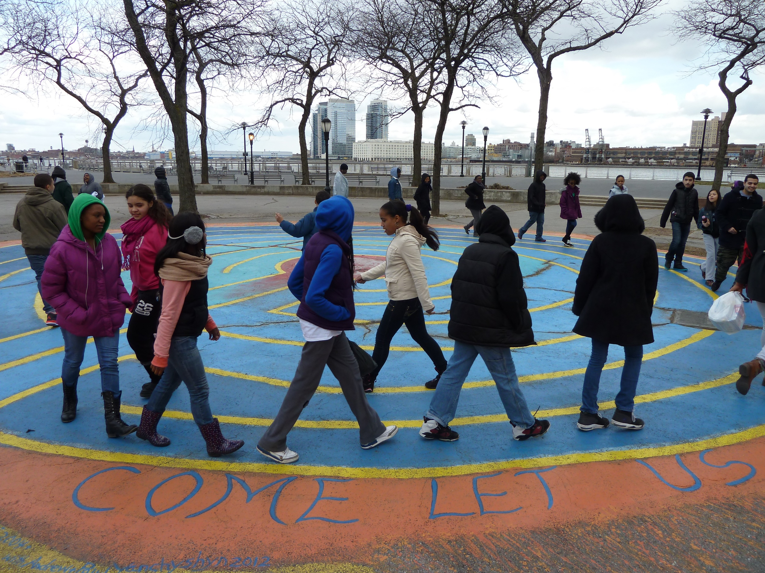 Learning about, making labyrinths, and walking together with Grand Street Settlement participants.