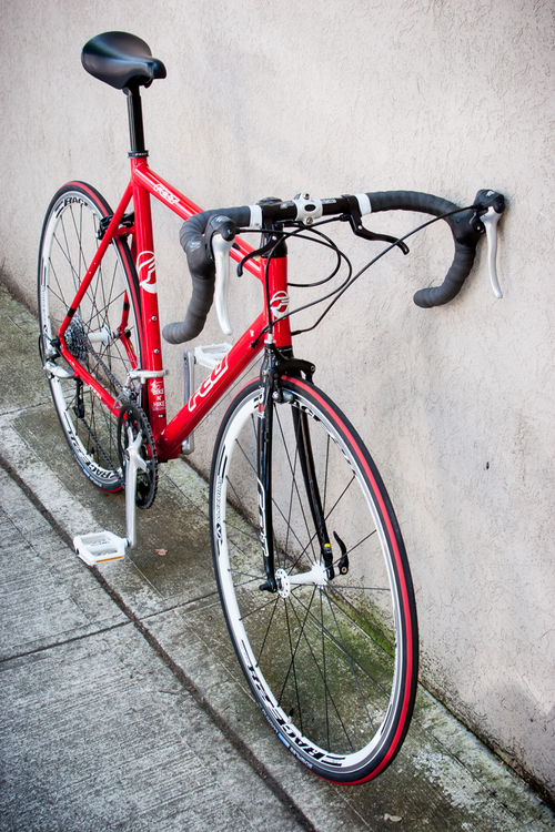 56cm Felt. Go fast road bike with 3x9 gearing.