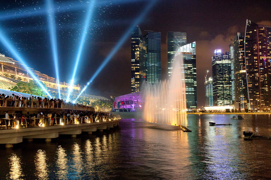 I hear the deep sound of the music for the light show at the Marina Bay Sands every night at 8 PM but hadn't manage to photograph it from the boardwalk until recently. Here is an image from last night--the particles in the air near the laser lights are bubbles (also on Google+).