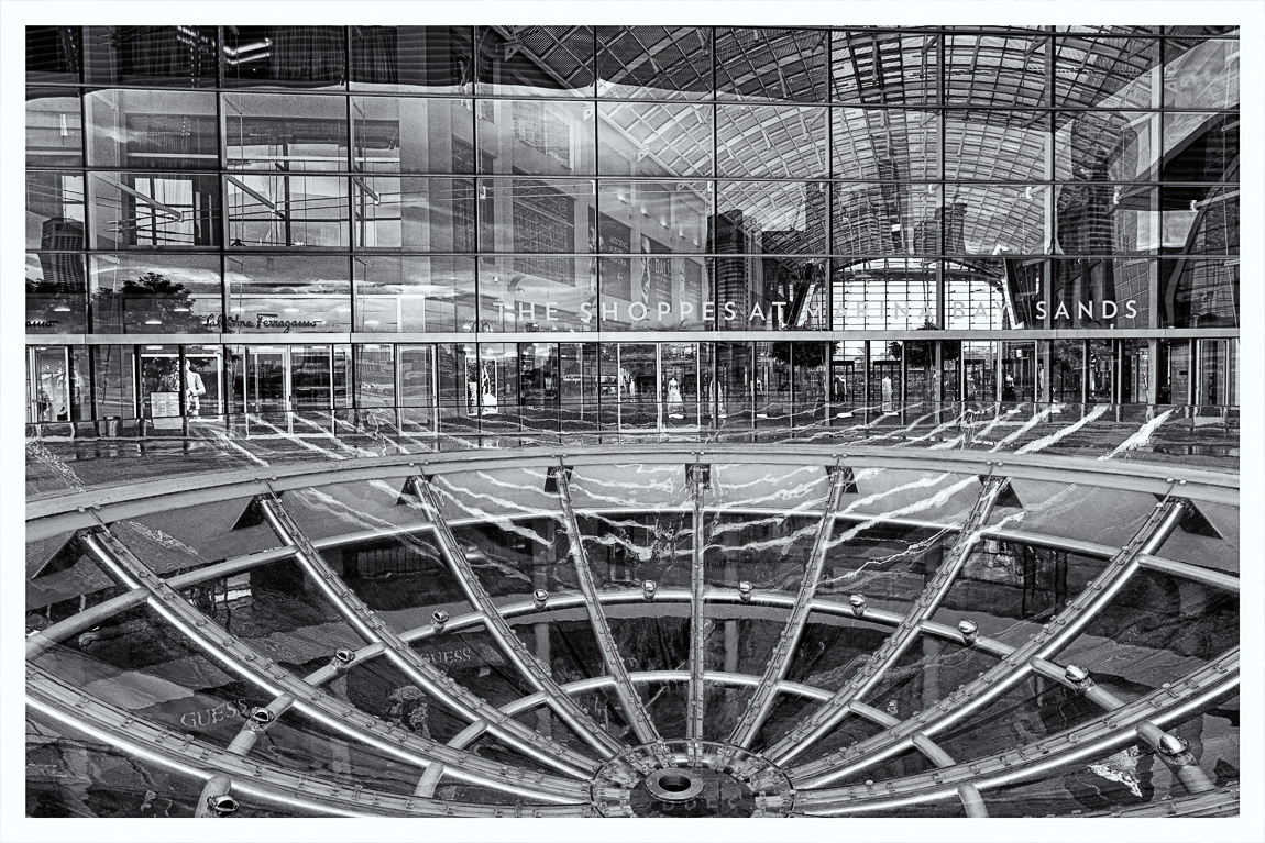 It rained over night which cleared the air and made it feel a bit fresher than normal this morning around Marina Bay in Singapore. Attached is an HDR image, converted to black & white of The Shoppes at Marina Bay Sands.