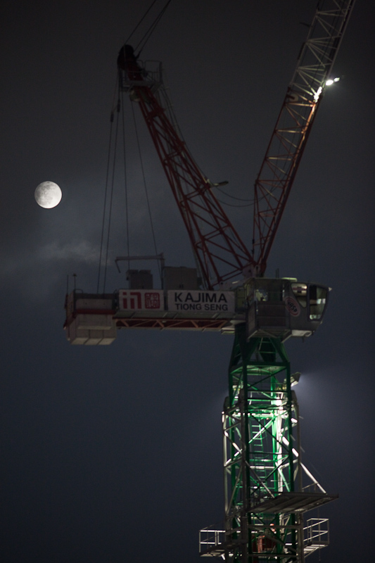A loud noise from the construction site next door drew my attention to the window this evening in time to capture this view of the full moon, here in Marina Bay, Singapore.