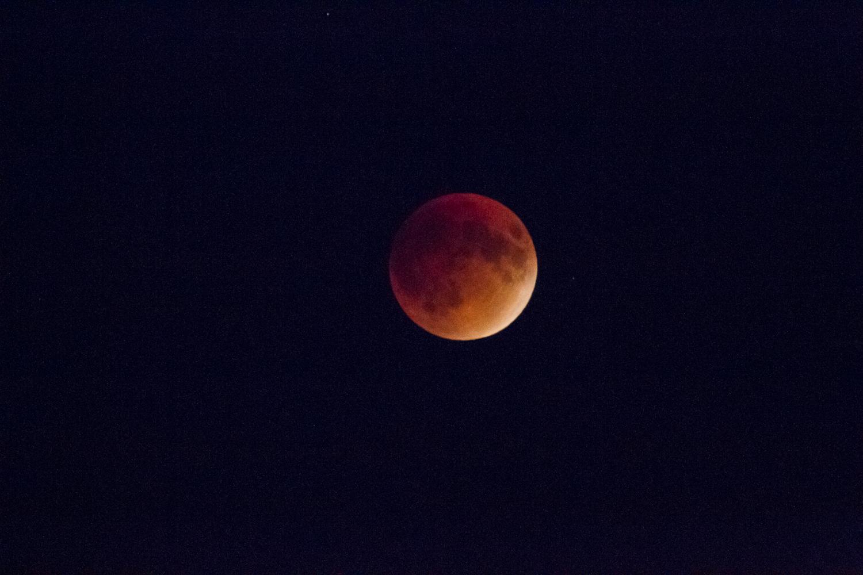 Full moon nearing full eclipse at Waterton Lakes National Park, Alberta, Canada.