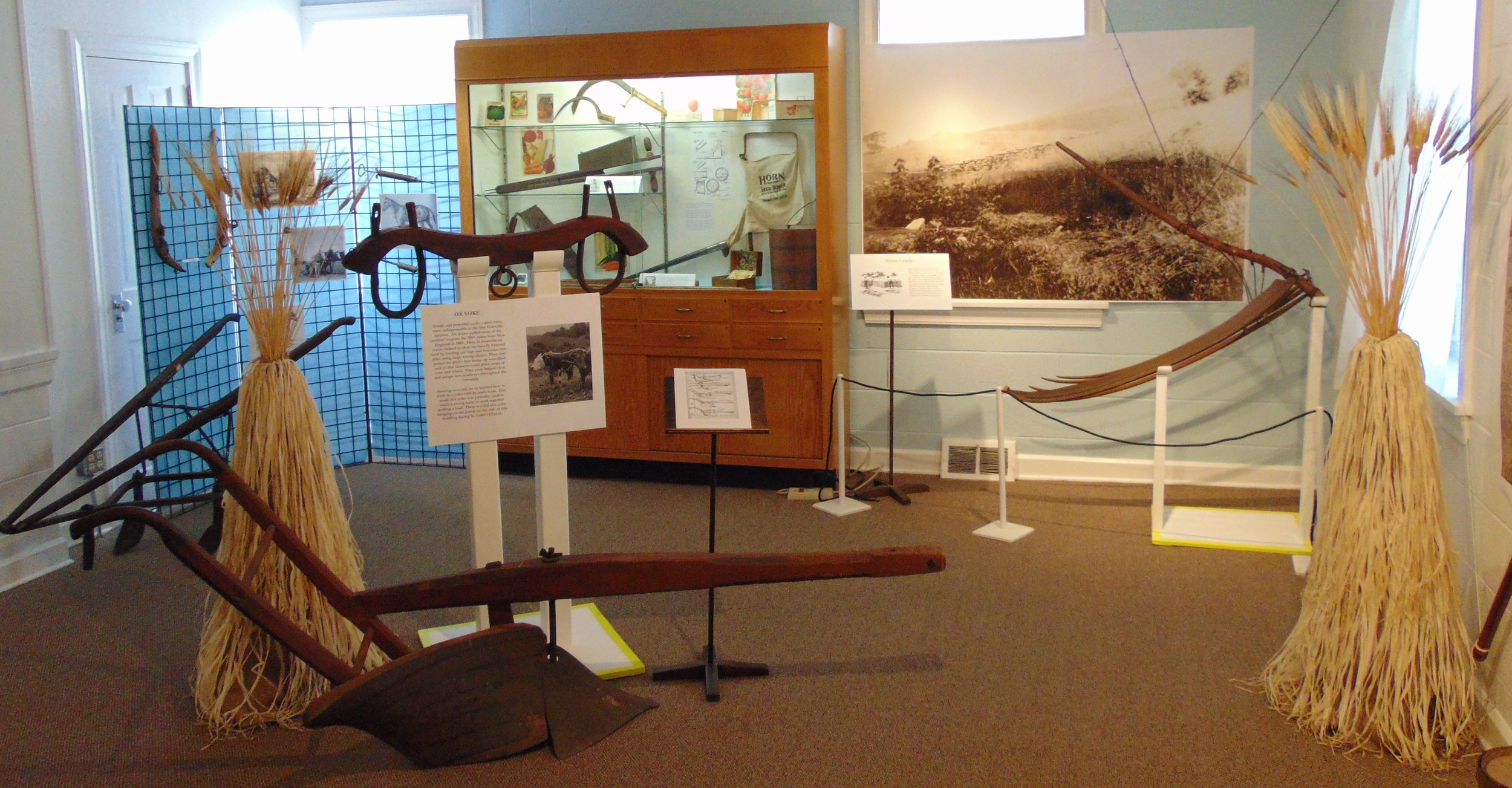 Our exhibit on farming features a range of tools and implements,including a plow, yoke, and scythe.