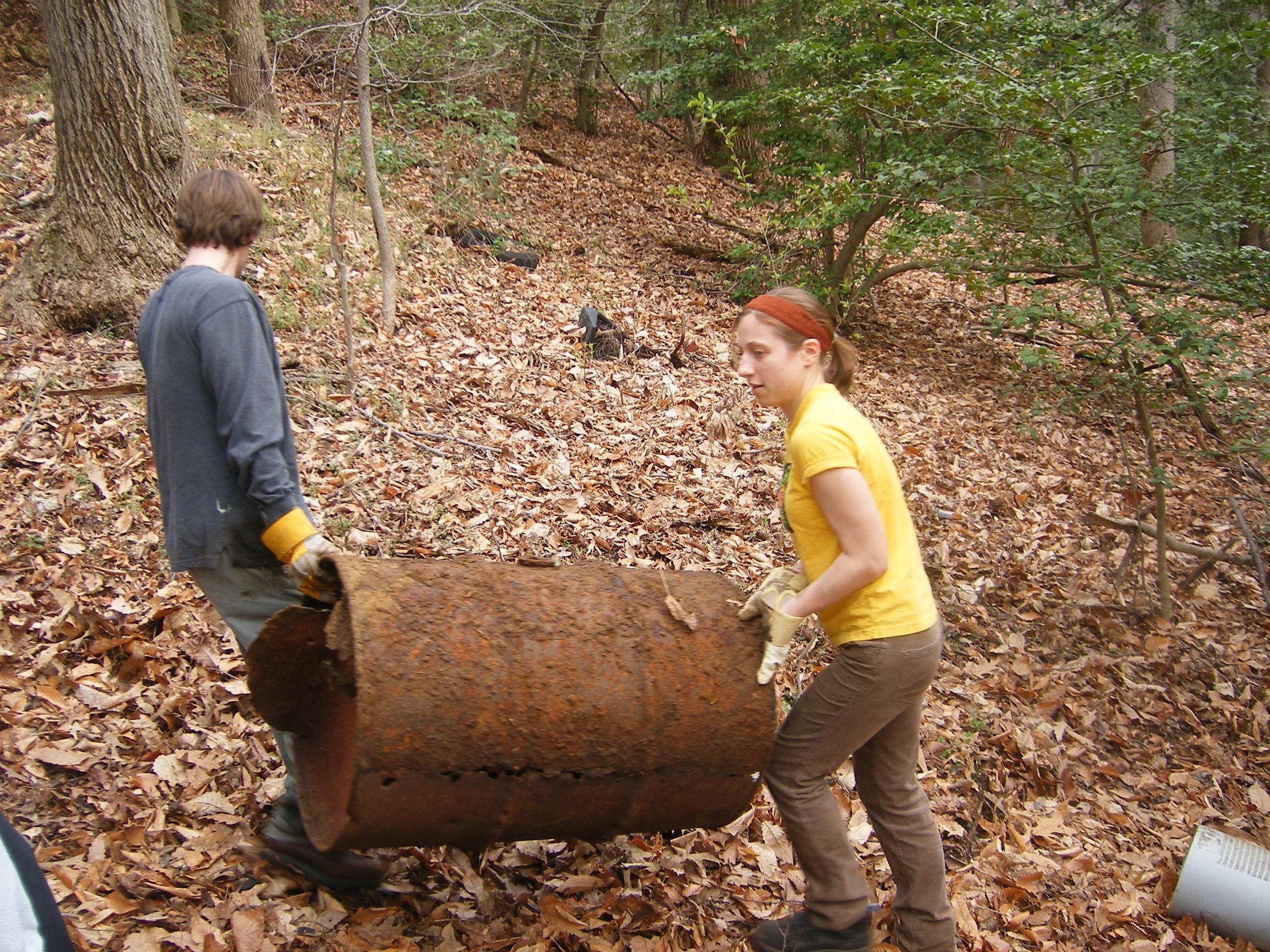 Volunteers helping remove large debris.