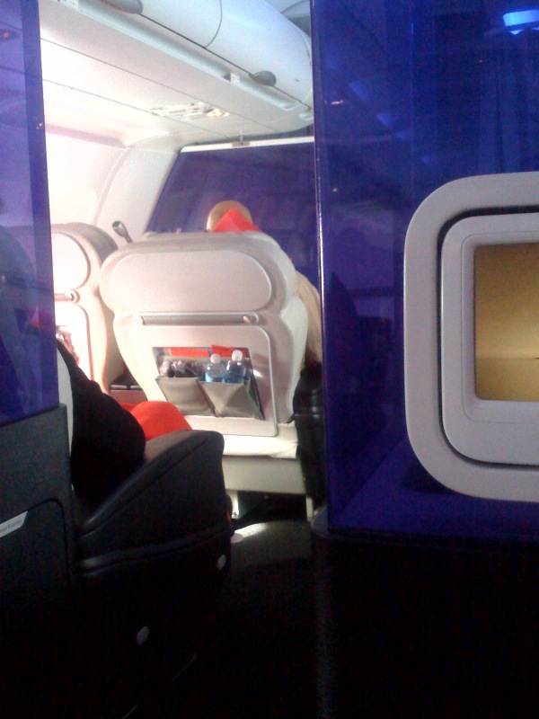 The view of first class on Virgin America, from the medium-priced seats. Air travel is super-glamorous.