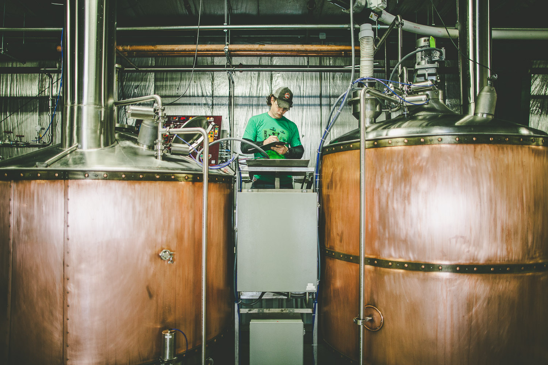 Brewmaster Tom Korder starts the boil.
