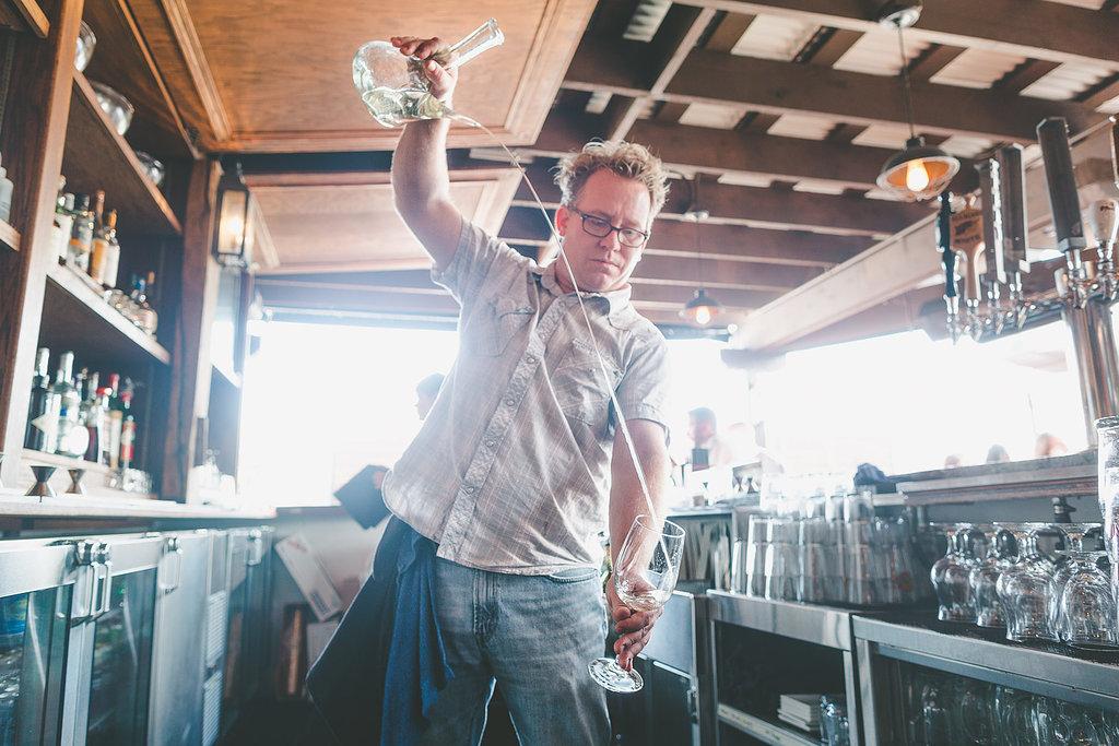 Brian Rutzen pouring a Spanish cider at The Fountainhead