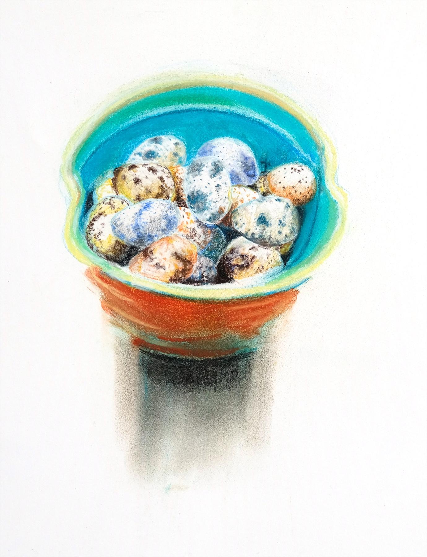Quail eggs in orange bowl