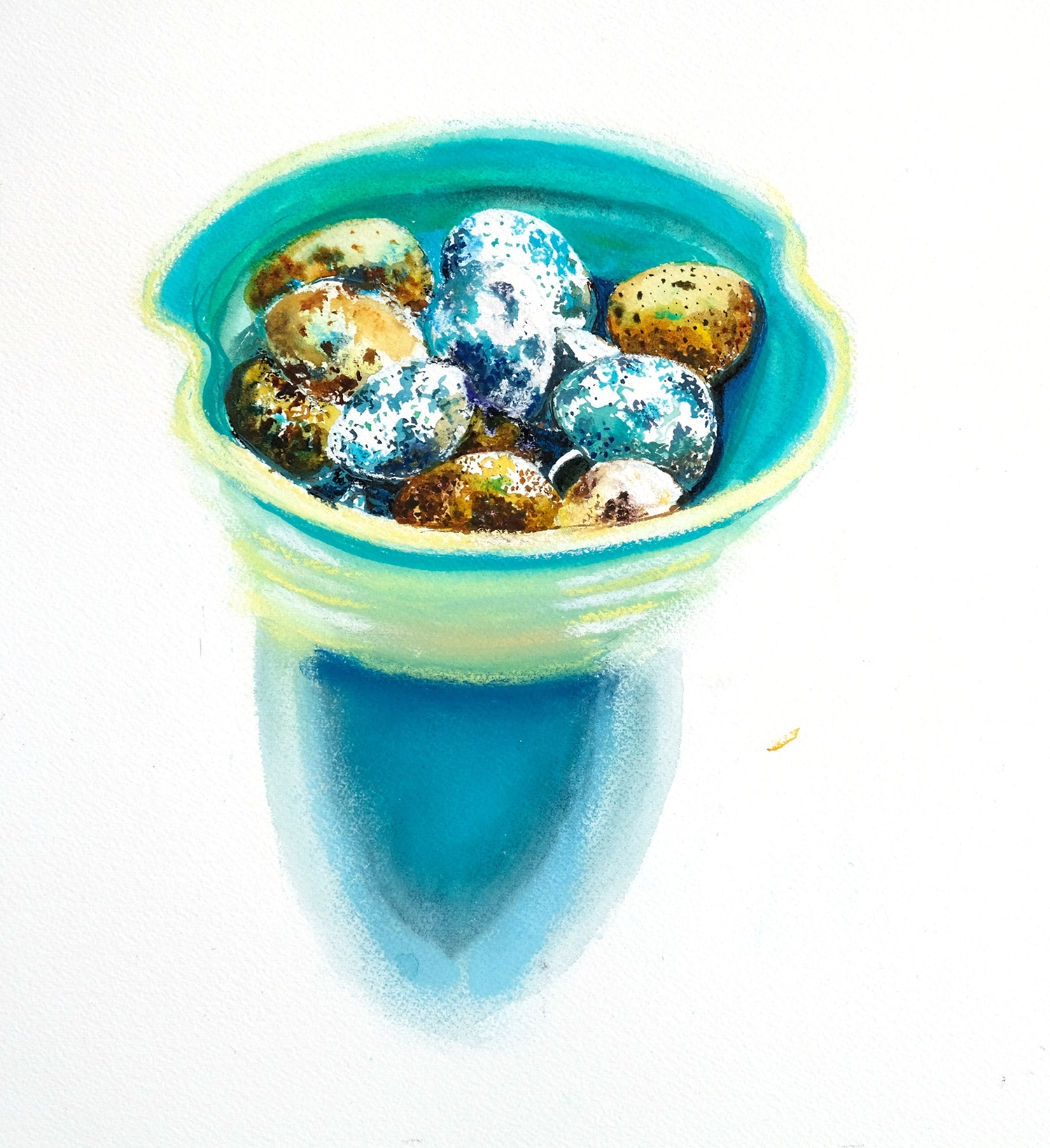 Quail eggs in turquoise and green bowl.