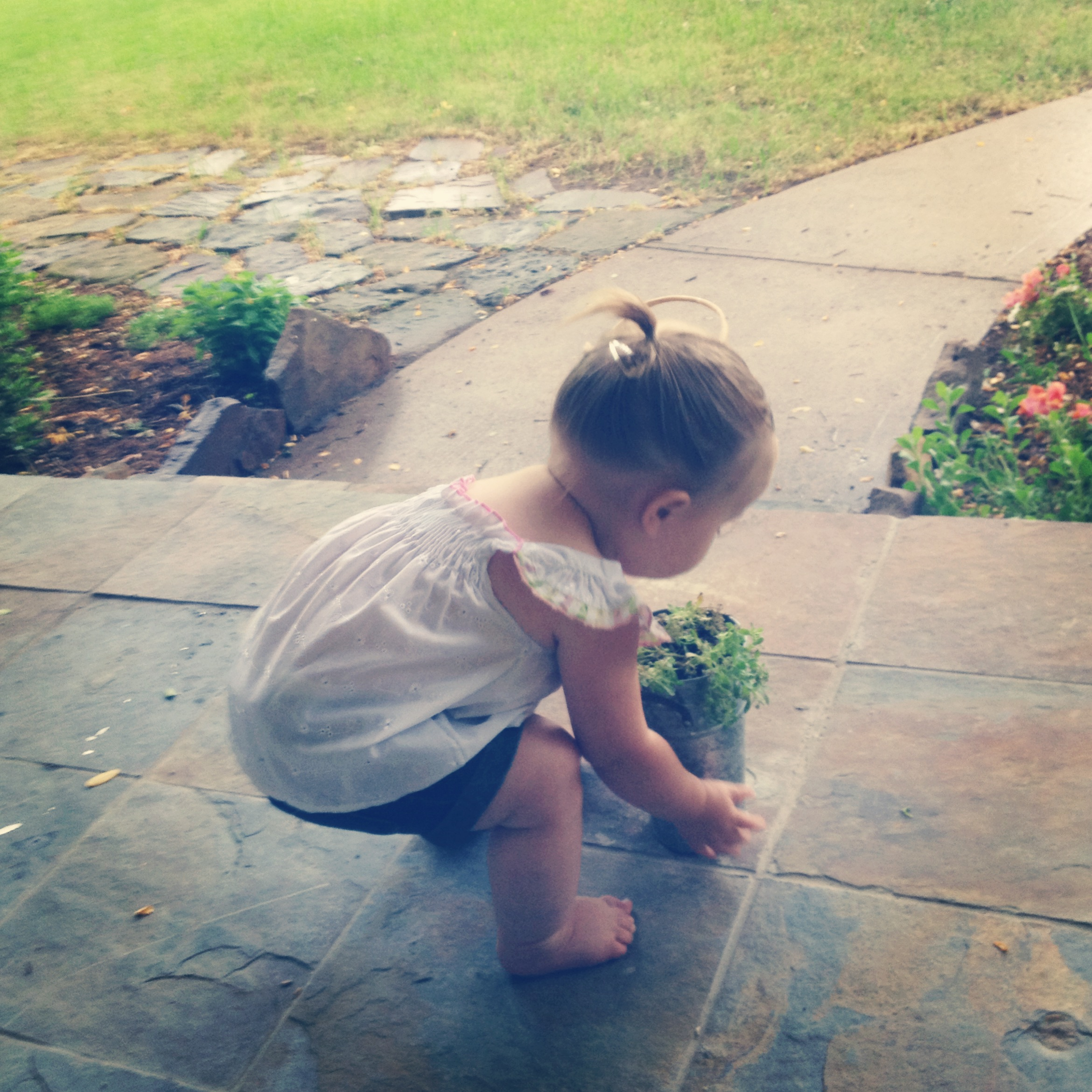 Tending to her plants.
