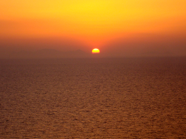 Sunset view from the island of Santorini, Greece, 2009.  It's hailed as one of the most beautiful in the world.