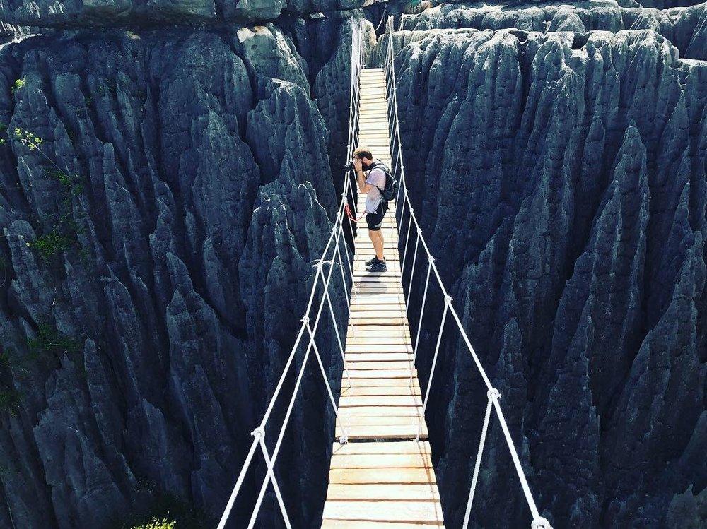 Thomas on an actually-quite-safe-feeling suspension bridge on top of the tsingys.