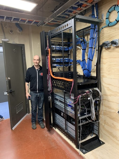 An advanced setup for a large (100K sq ft) space. You can see the wiring from the building (blue) wrapped cleanly and terminating into the back of the patch panels (far side).