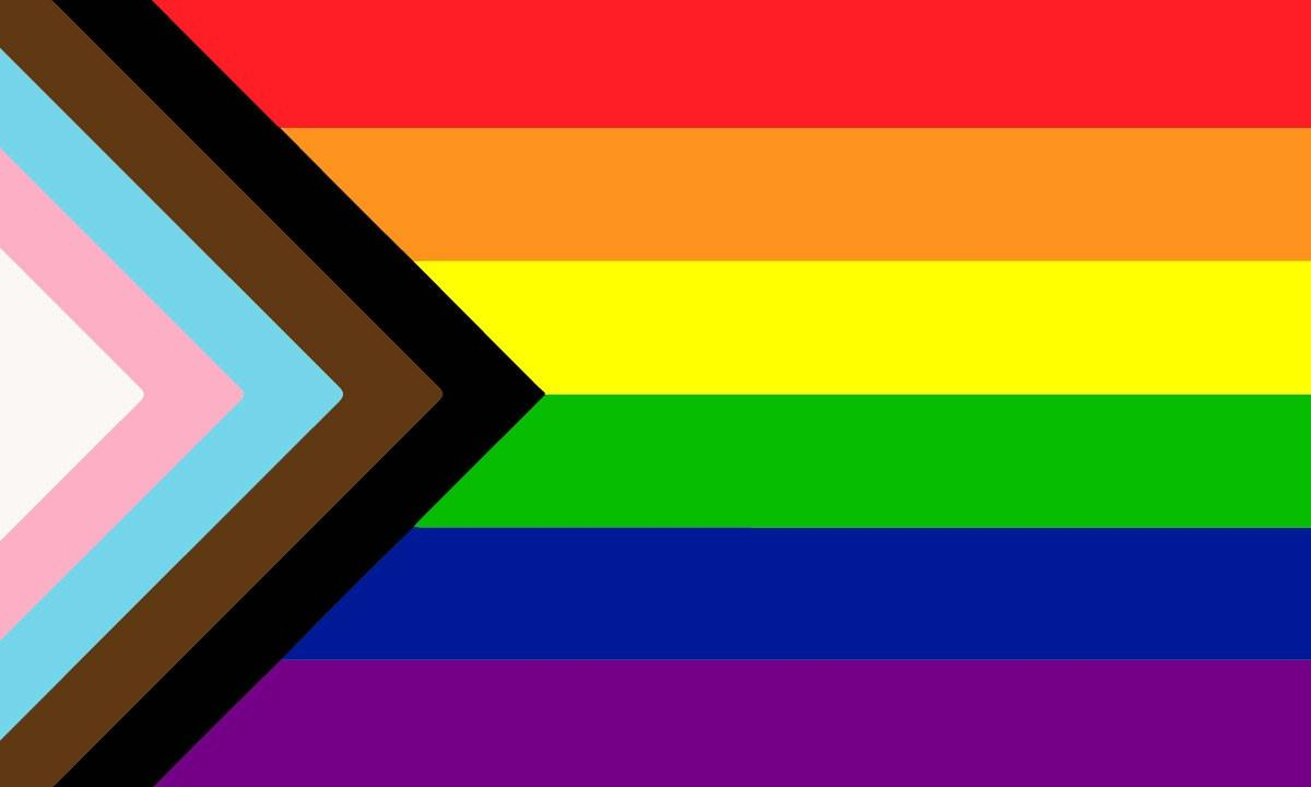 Image description: The new pride flag designed by Daniel Quasar recognizes trans identities and people of colour in the pride flag.
