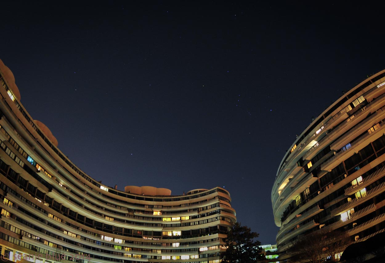Infamity: Watergate under Orion, shot with a fisheye lens, making the place even more absurd than it already seems.