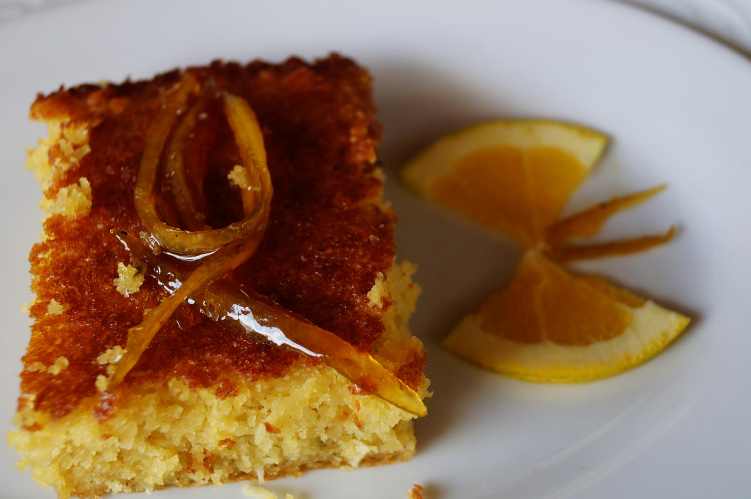 An after lunch dessert, made with a sweet corn flour and orange, topped with some kind of sweetened/candied orange peel, with a cute butterfly :-)