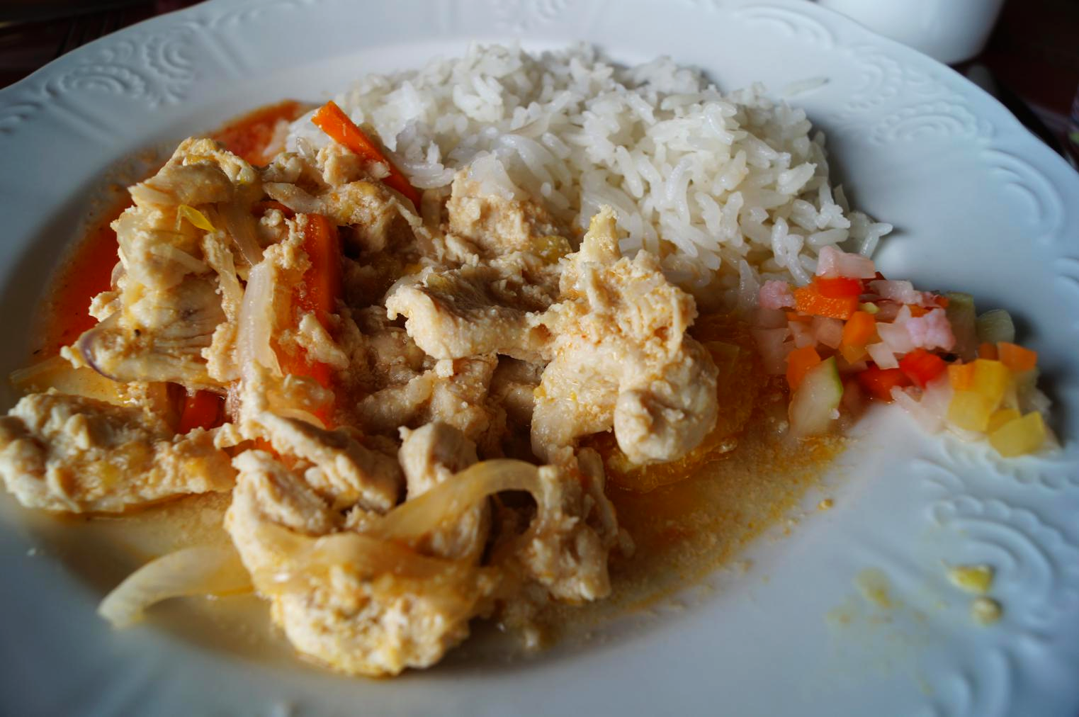 A lunch. Lemongrass chicken and rice with homemade hot sauce and pickled veggies.