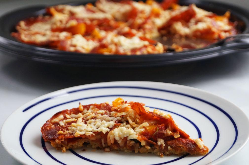 Cauliflower-Crusted Pizza slice